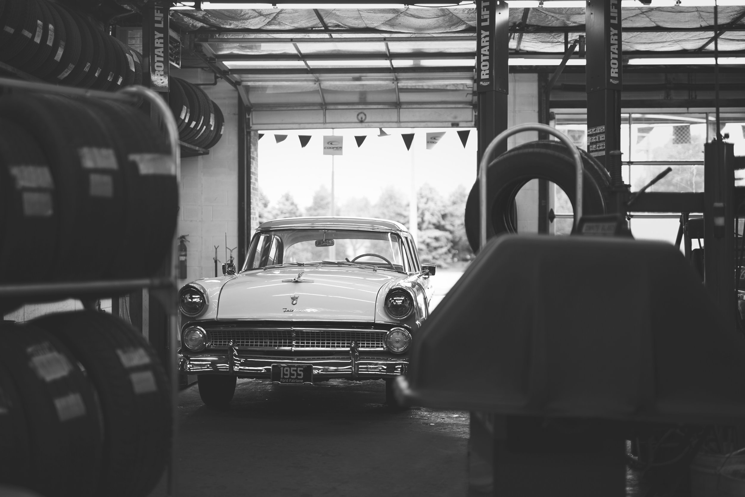 Black and white auto commercial photo of vintage car in garage in Springfield, Illinois.
