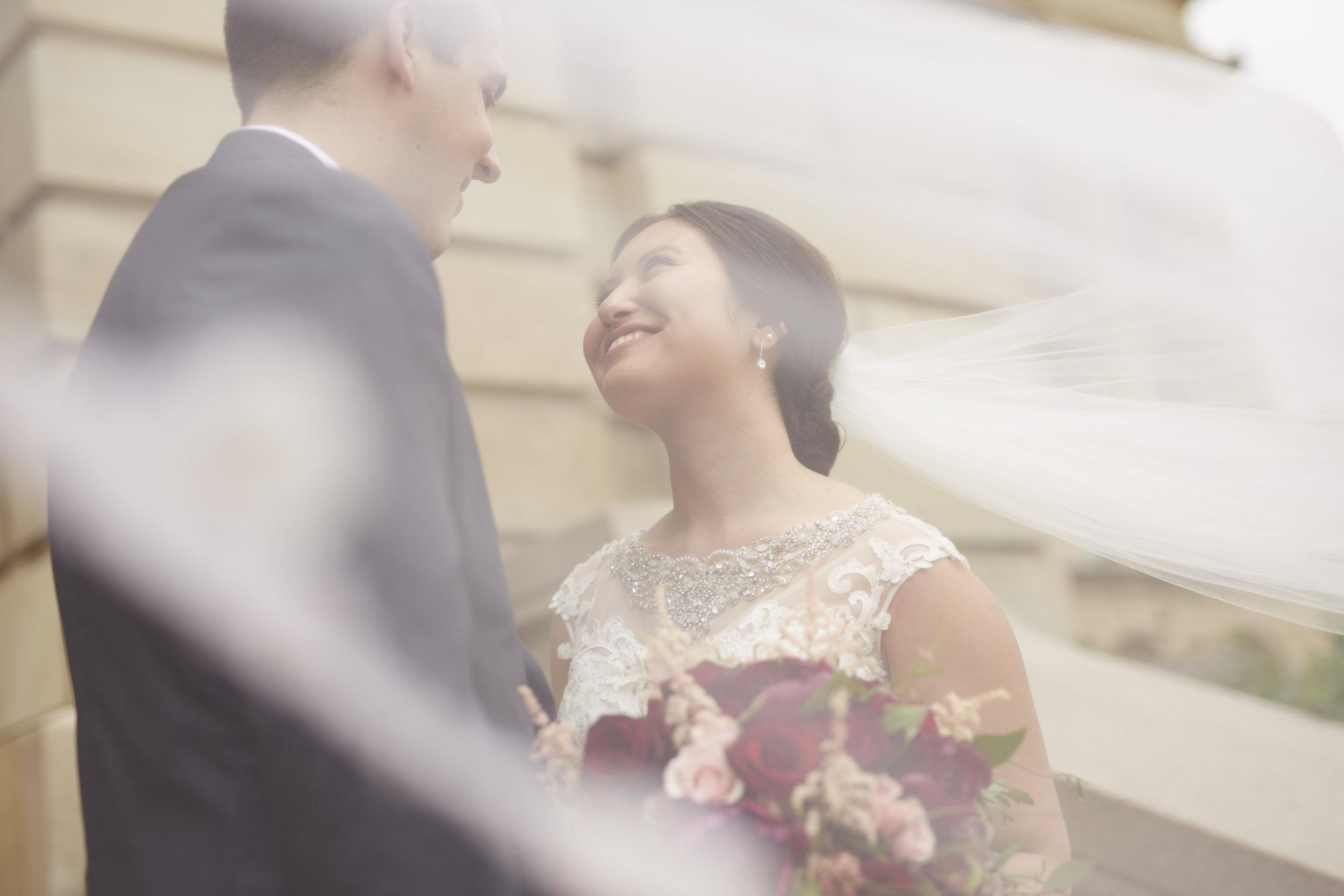 Bride and Groom Under Veil