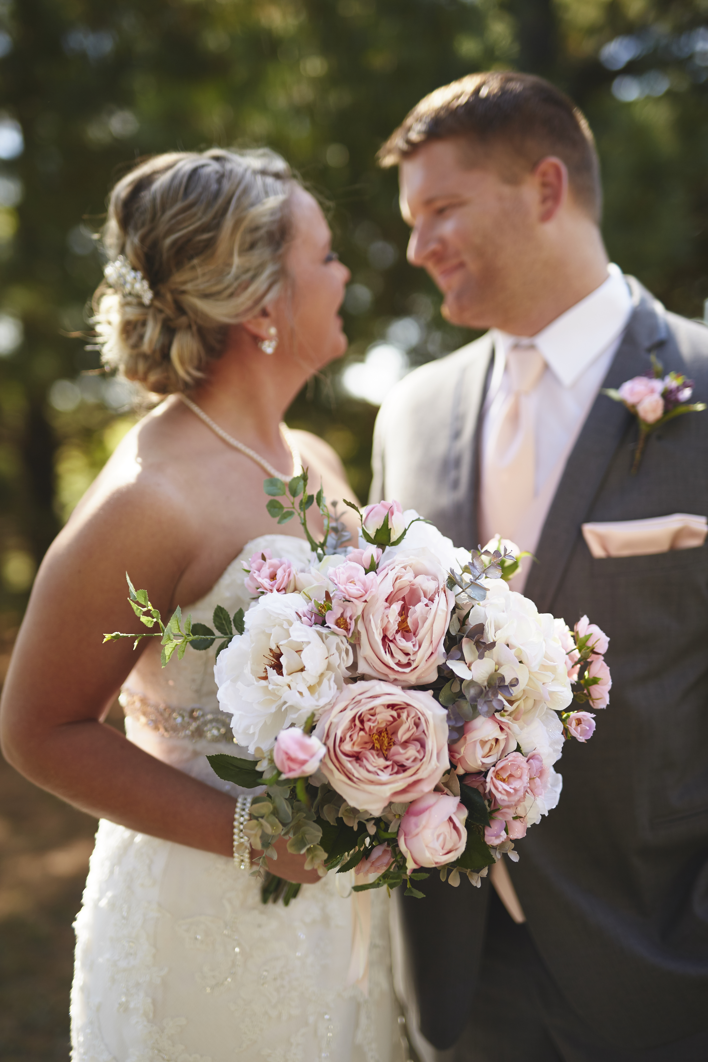 bride and groom portrait with flower bouquet