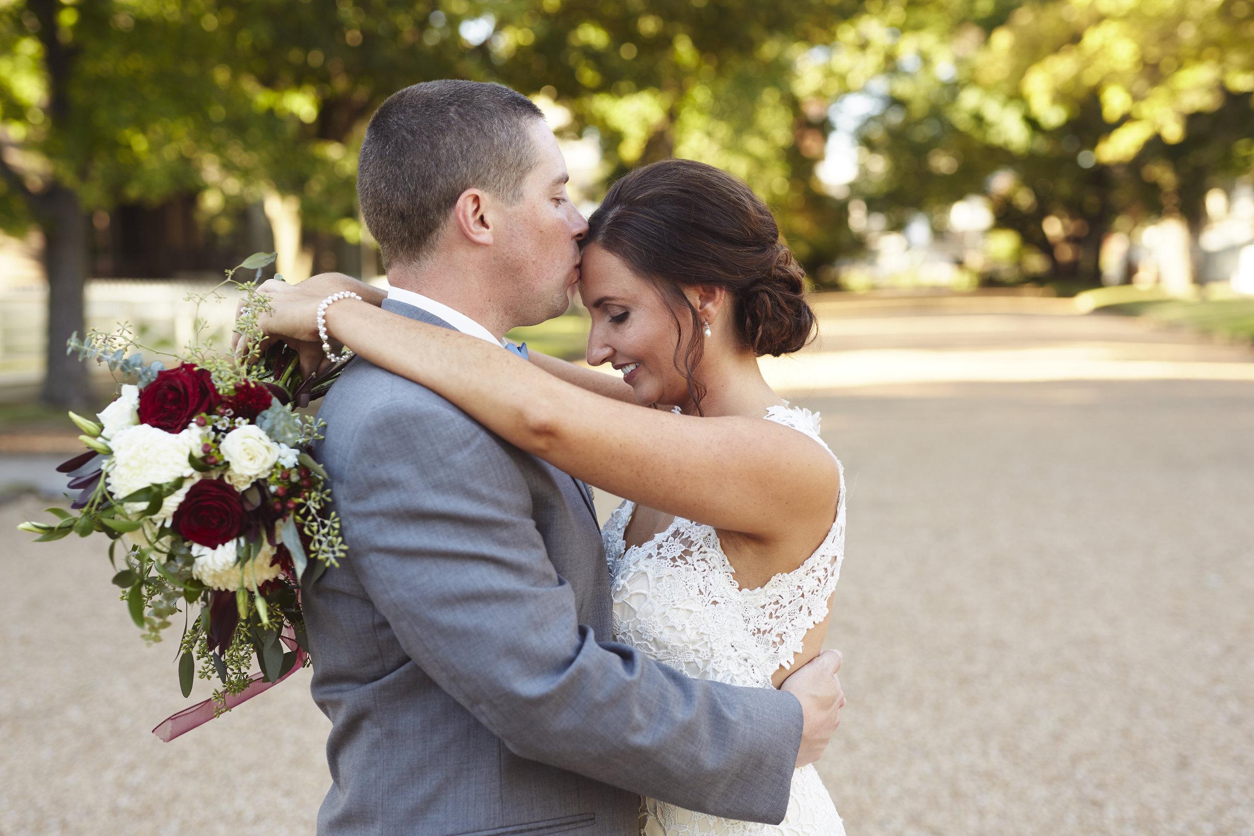 married couple outdoor wedding portrait