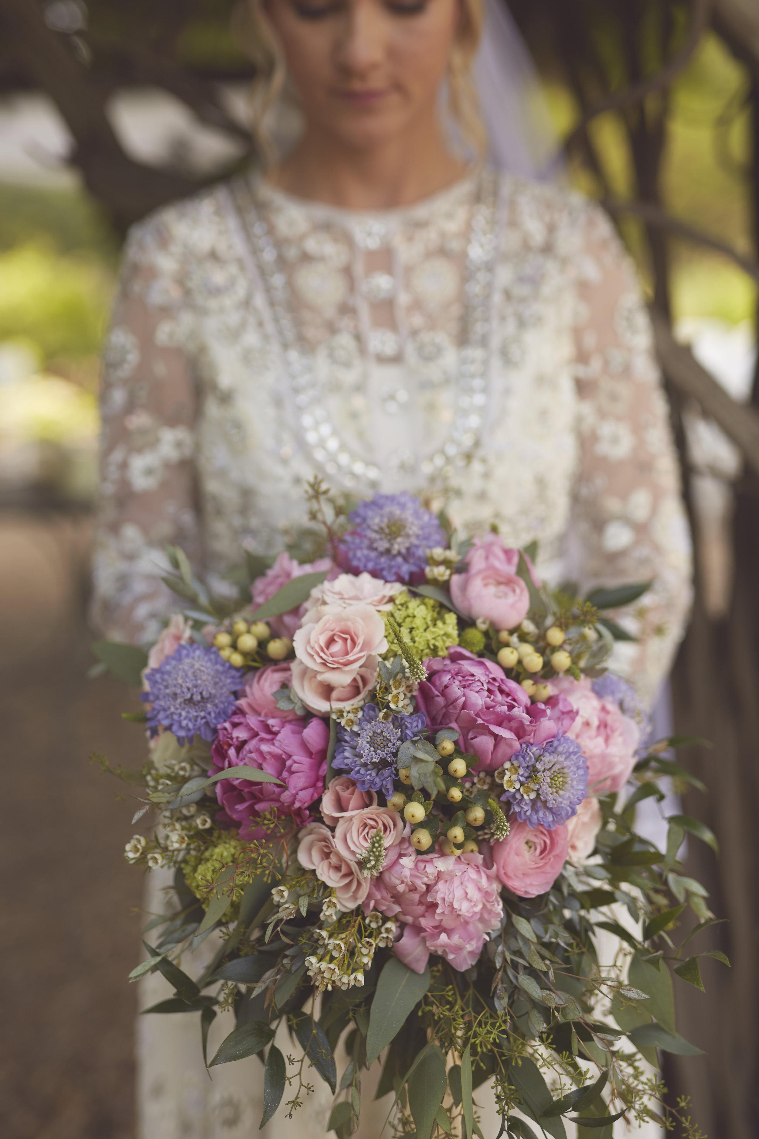 bride wedding portrait with flower bouquet