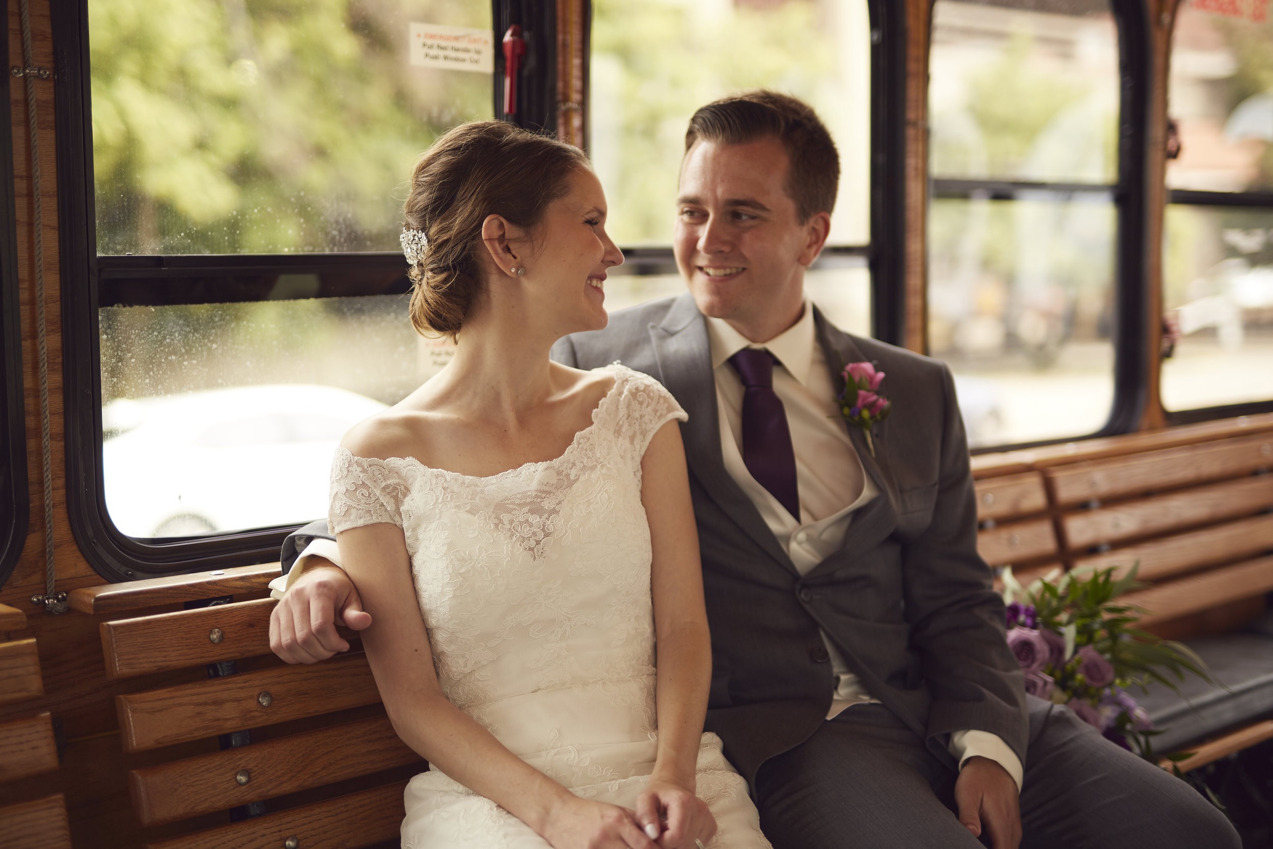 bride and groom portrait on trolley