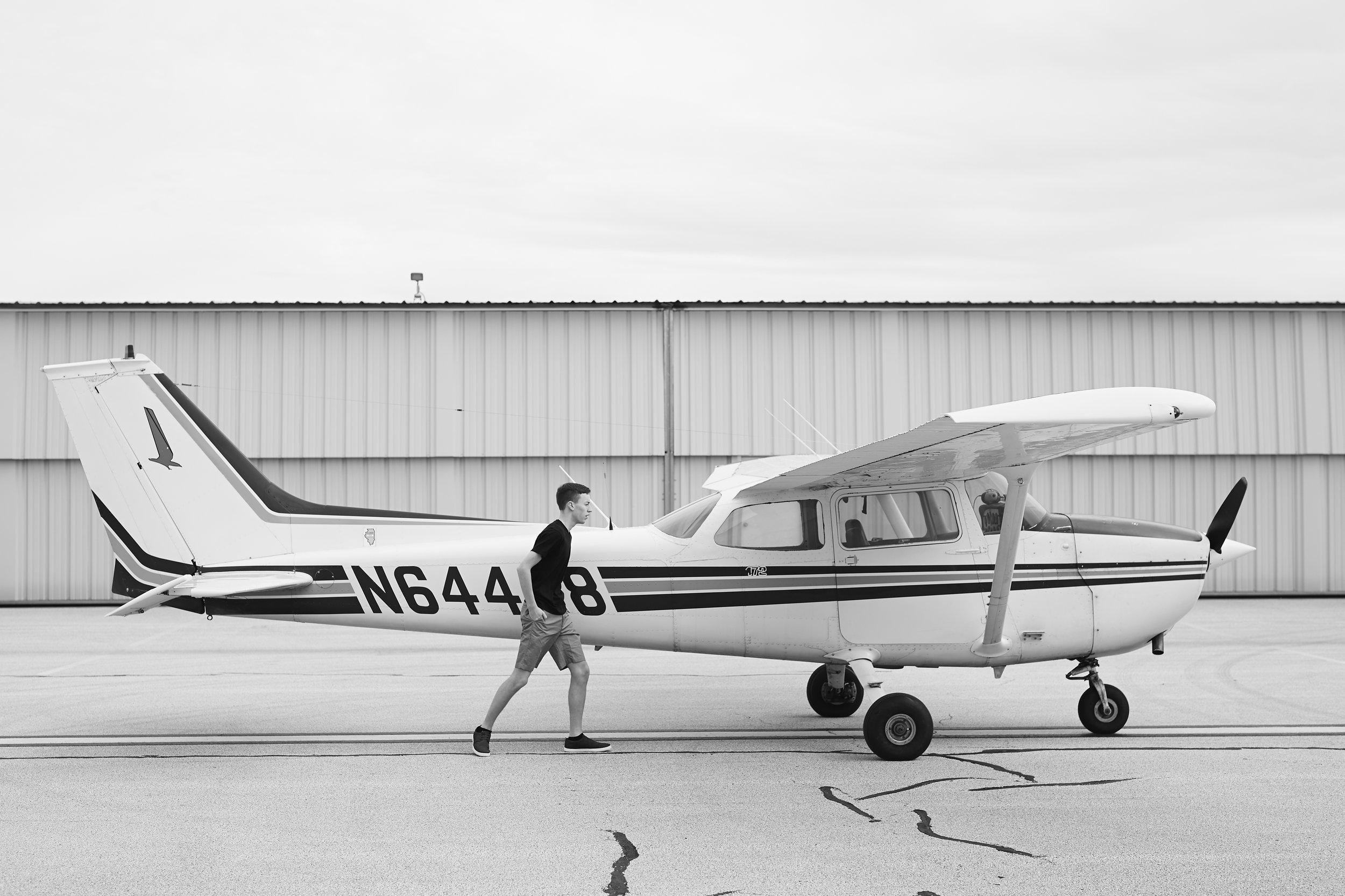 black and white airplane senior shoot at airport
