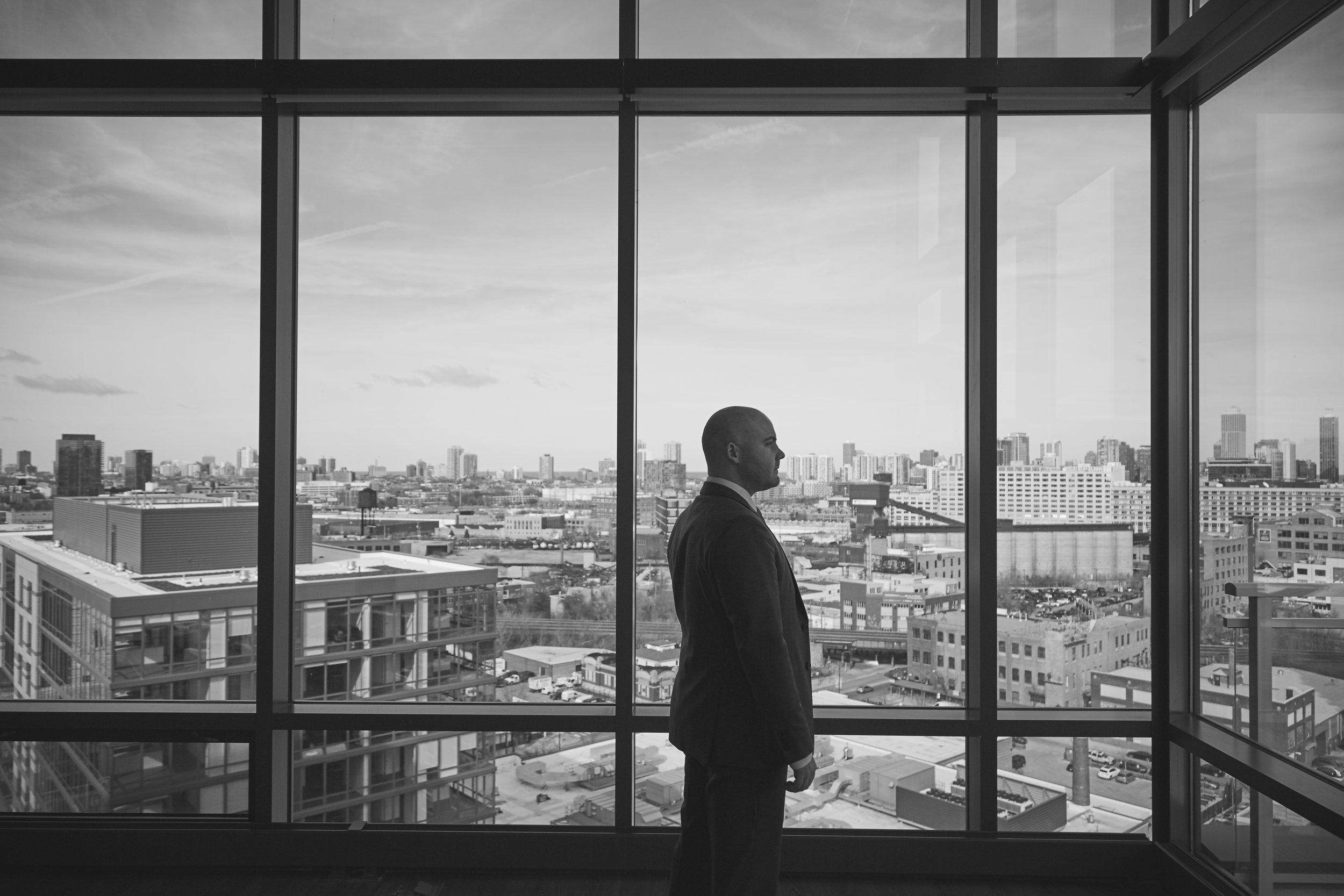 black and white portrait of businessman with view of city