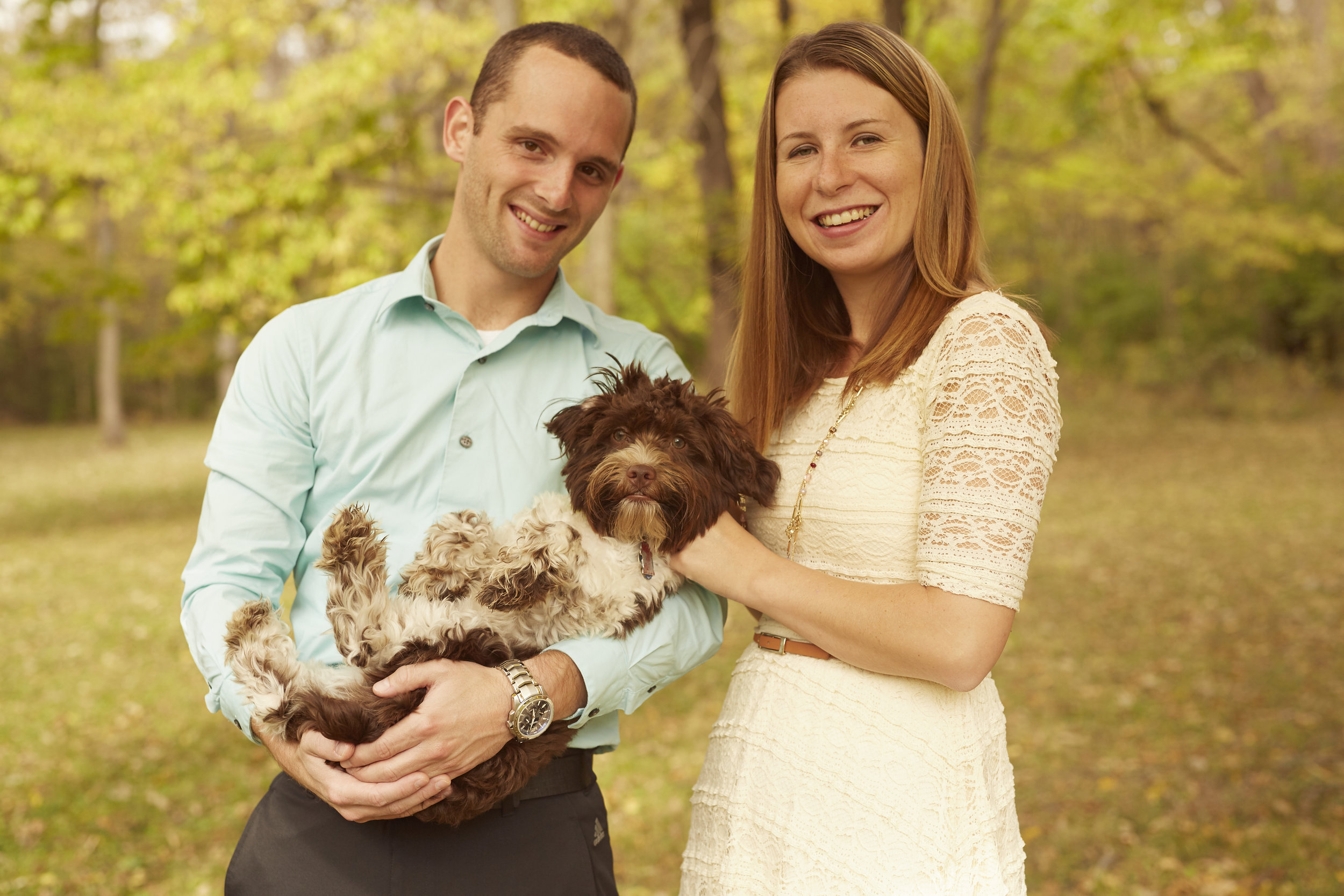 outdoor engaged couple with pet dog
