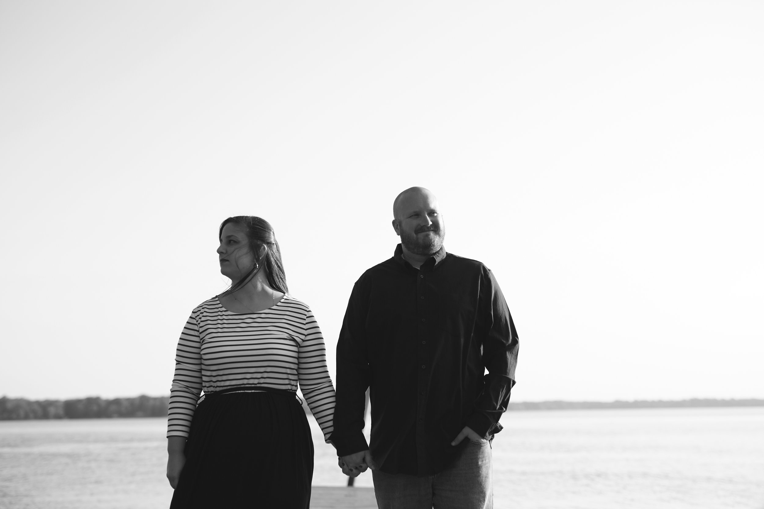 classic black and white portrait of couple by lake