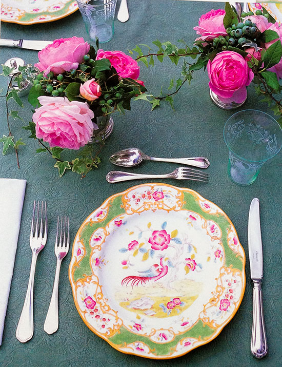 Carolyne Roehm's pink and green antique chinoiserie plates look stunning with roses and ivy in silver julep cups. She purchased these as a young woman with no expendable income, and they survived the fire. This photo is from her book,   At Home with Carolyne Roehm  .