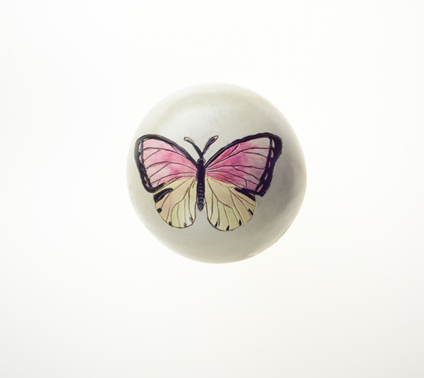 Pair of wooden butterfly spheres. More information    here   .