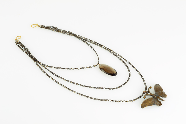 Vintage Art Deco charms on bronzed metal chain. More information    here   .
