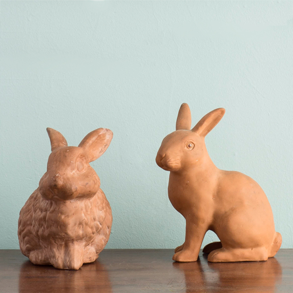 Pair of vintage terra cotta rabbits. More information    here   .