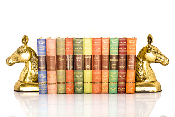"""This collection, """"Great Illustrated Classics,"""" contains eleven legit novels and brass bookends. The book bindings are stunning, and purchasing    this set    is the equivalent of taking English 101 and Color Theory, all while riding a horse."""