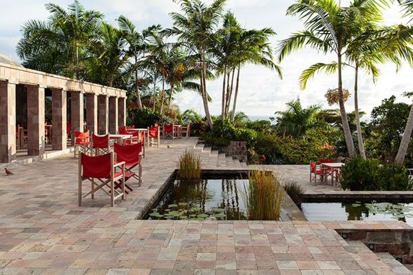A beautiful outdoor space (above) in the Caribbean and the rows of tables and chairs look fine. But we all know that director's chairs are just kites parading as furniture. One gust of wind and everything on this patio will be airborne.  Photo by Ingalls Photography via    Lonny Magazine   .
