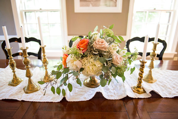Vintage brass candlesticks and pedestal stand. Aren't those orange roses so over-the-top and luscious?
