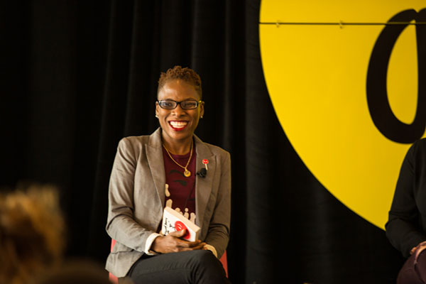 """Luvvie Ajayi spoke emphatically about being a straight shooter with strong opinions on her corner of the Internet. """"I run a dictatorship, not a democracy."""" Luvvie reports that in the past three years, as she became more outspoken, her income from sponsorships increased. Photo by Justin Hackworth."""