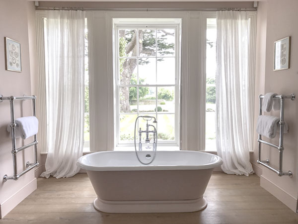Nothing makes you feel more youthful than soaking in a tub the color of a nymph's thigh while gazing upon the gnarled branches of a two-hundred-year-old cedar out the window.