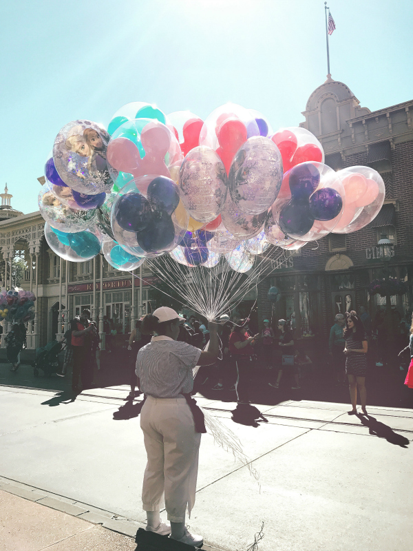 Do you see the Gary finger puppet floating among the beautiful Mickey Mouse balloons? He's there, barely visible, but flying high.