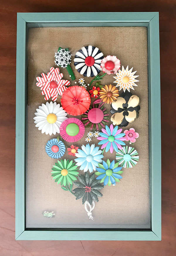 "Margaret calls this shadowbox full of 1960s pins her ""Flower Power Bouquet."" I have a miniature version of it in the shop today. It's at the end of this post."
