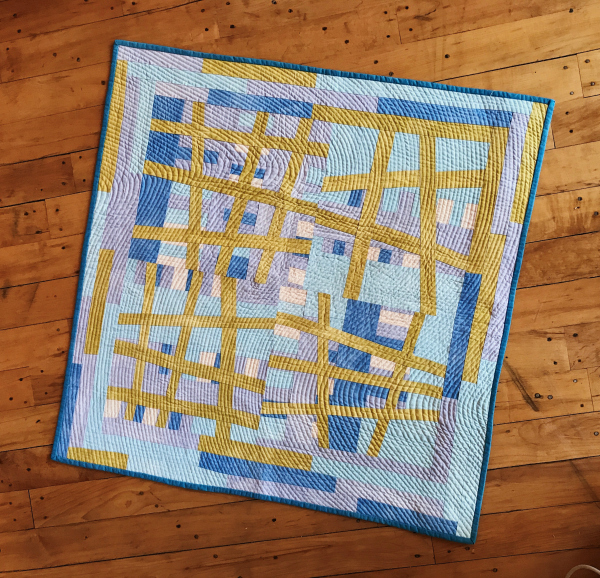 Cathy made this quilt during a six-month sojourn in Oxford, England, using a cheap Singer sewing machine that she purchased and lugged home on the bus. I love the abstract lines and how the curved hand stitching creates an effect of undulating motion.