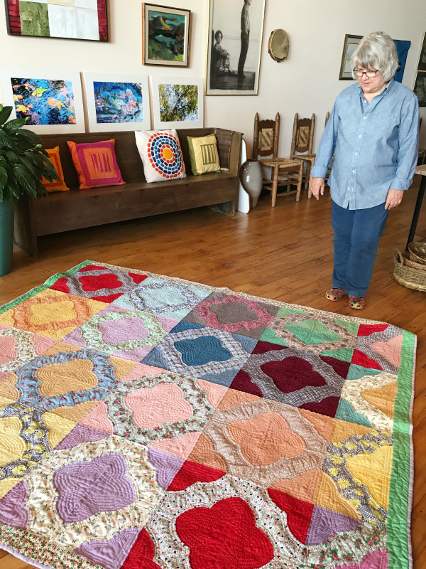 """Cathy purchased this """"hearts and gizzards"""" piece unfinished on eBay. It took her two years to hand quilt it. I asked Cathy why she feels compelled to finish a long-dead stranger's quilt when she has so much modern quilting of her own to do. """"I love the history and the mystery,"""" she said. """"I want to honor their work by completing the piece. And I'm a process person. I'm not in a hurry."""""""