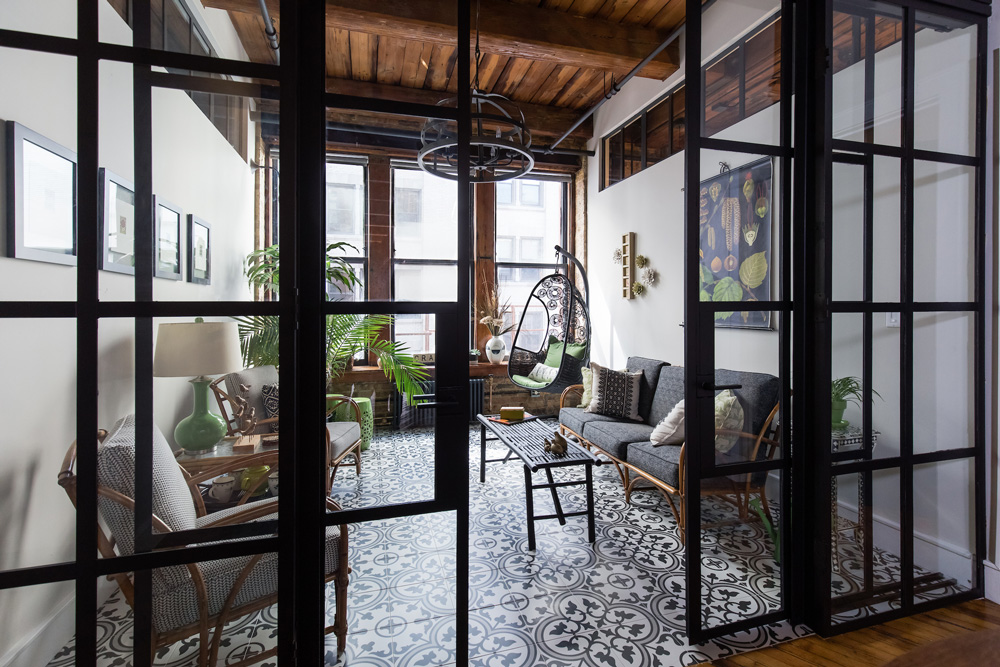 The Japanese-style doors slide closed, creating a private little oasis in an open concept home. I adore the hanging rattan chair but was scared to sit in it.