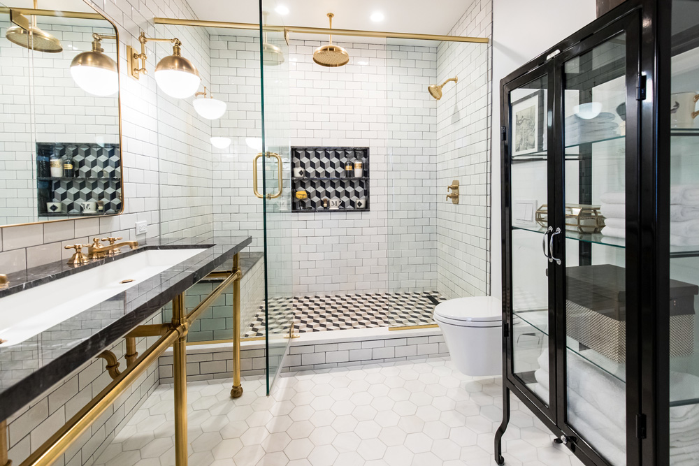The master bath has the flavor of an apothecary—love the metal and glass case— and a level of cleanliness that certainly would have met with approval from Harlene's grandfather.