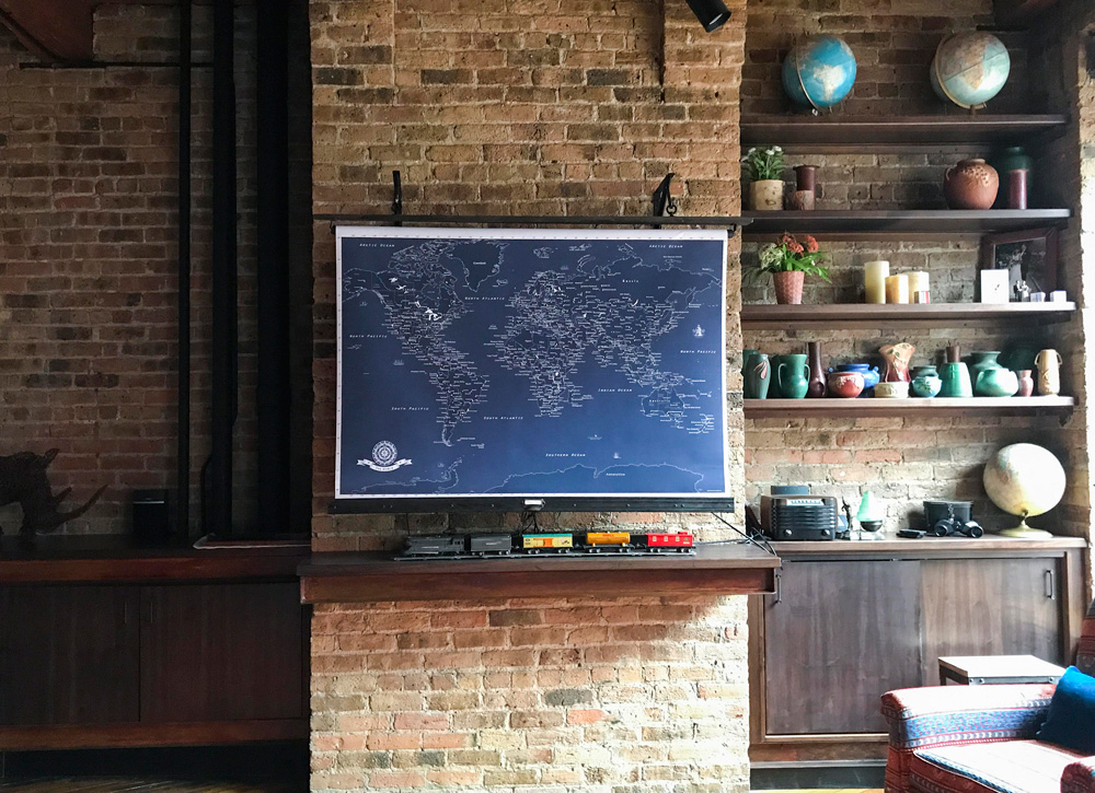 The custom roll-up map on the wall hides the television. The Lionel trains belonged to Mike's father, who worked for Frisco in St. Louis and then Grand Trunk in Detroit. The vintage radio belonged to Mike's grandfather.