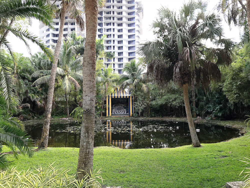 The Pavilion overlooking the lily pond where the bonnet lily grows. Note the close proximity of the high rise. Hurricanes Wilma and Katrina did a lot of damage to the upper canopies surrounding Bonnet House. I bet someone up there is taking a pic of me taking a pic of them.