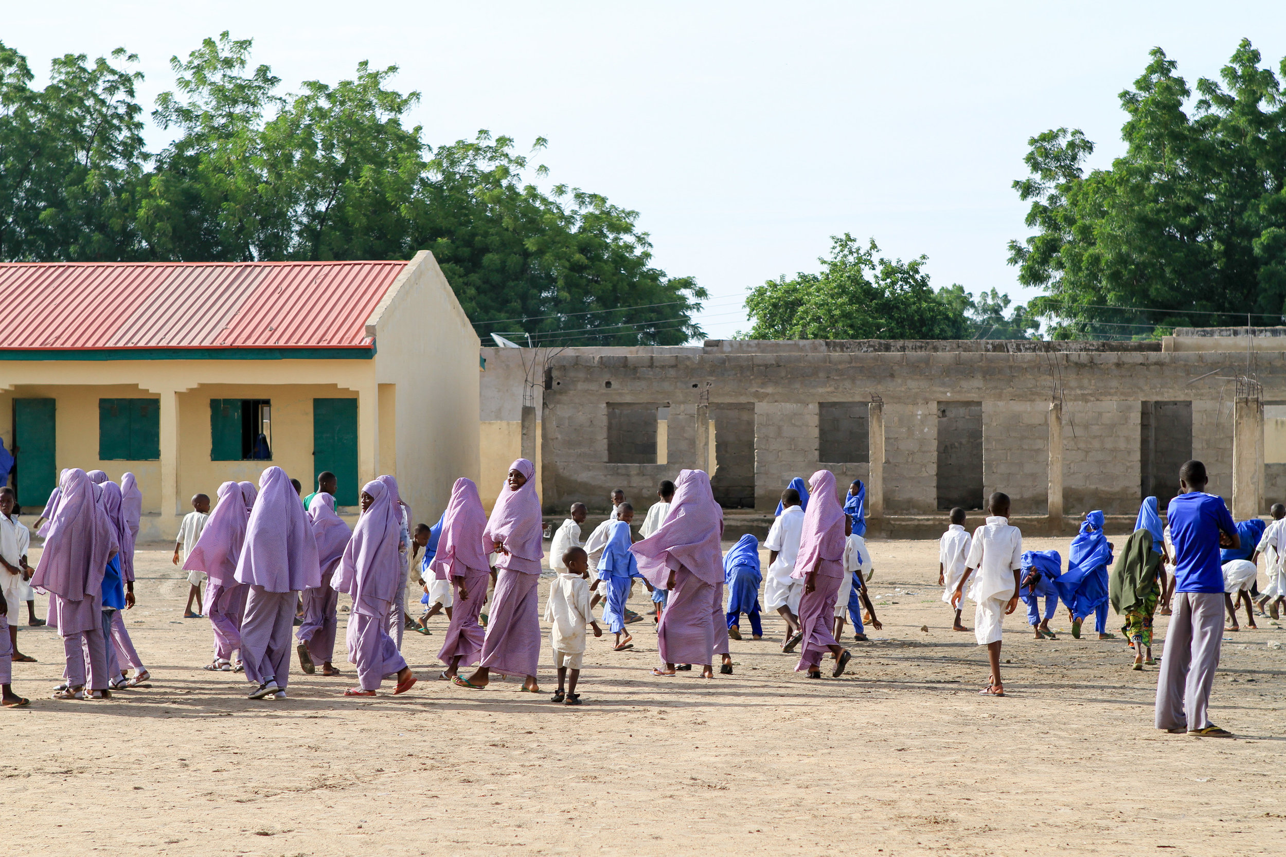 As the bell rings, the kids run back to their classrooms.