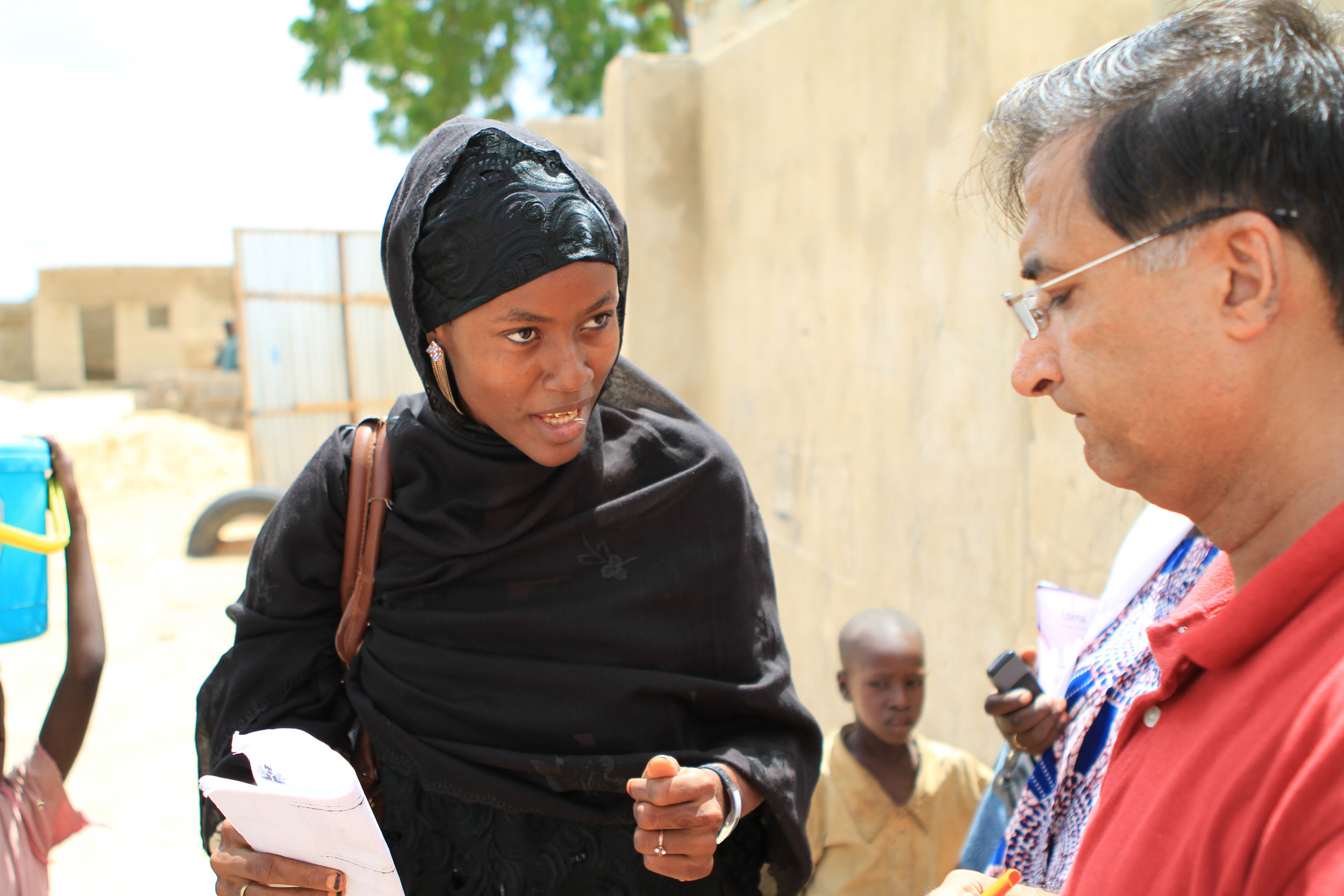 A polio vaccinator definitely knows her stuff, as she explains her work to my colleague Shahzad.