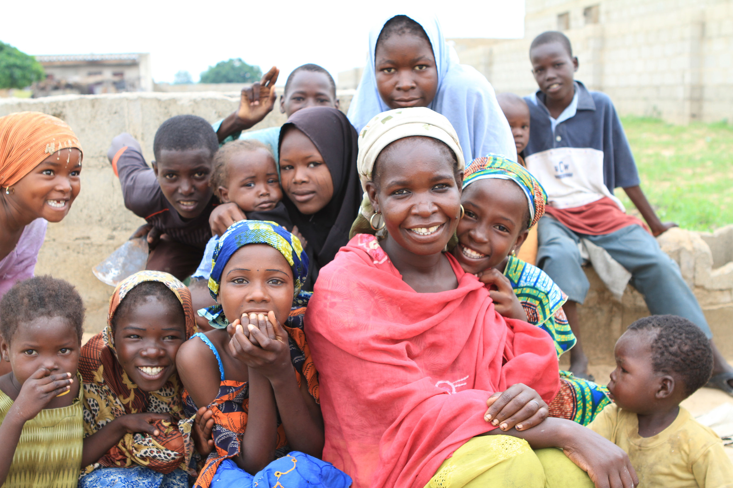 """Ok, this was in a """"Boko Haram"""" area. At that time, it was challenging to enter these areas as people were suspicious. But, note the girl with the orange headscarf on the left."""