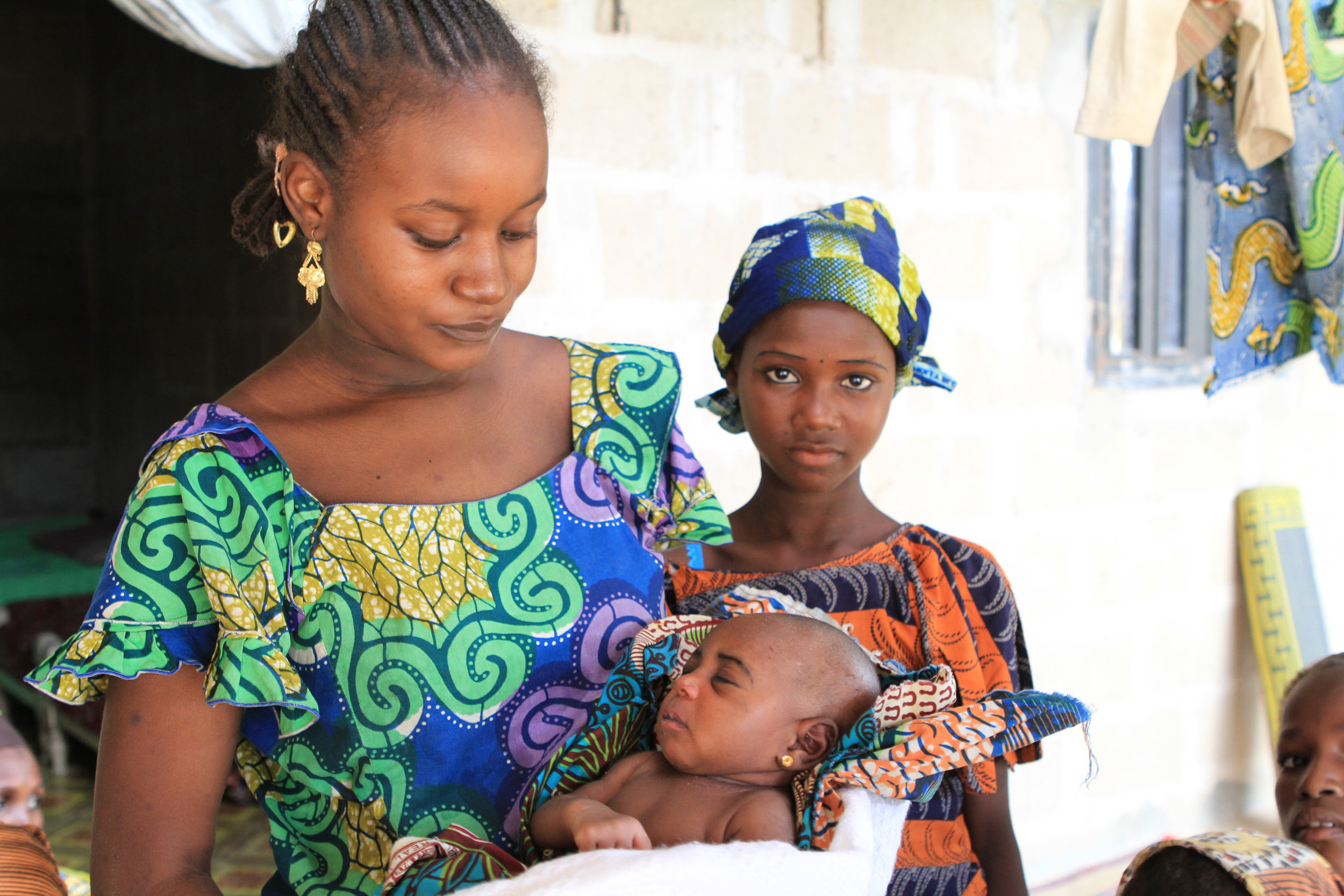 Her older sister came out with this baby. This was hard, as the baby was really really sick. We offered some money so she could take the child to hospital. I don't know if the baby made it. The father in the house was a Boko Haram member, I learned later.