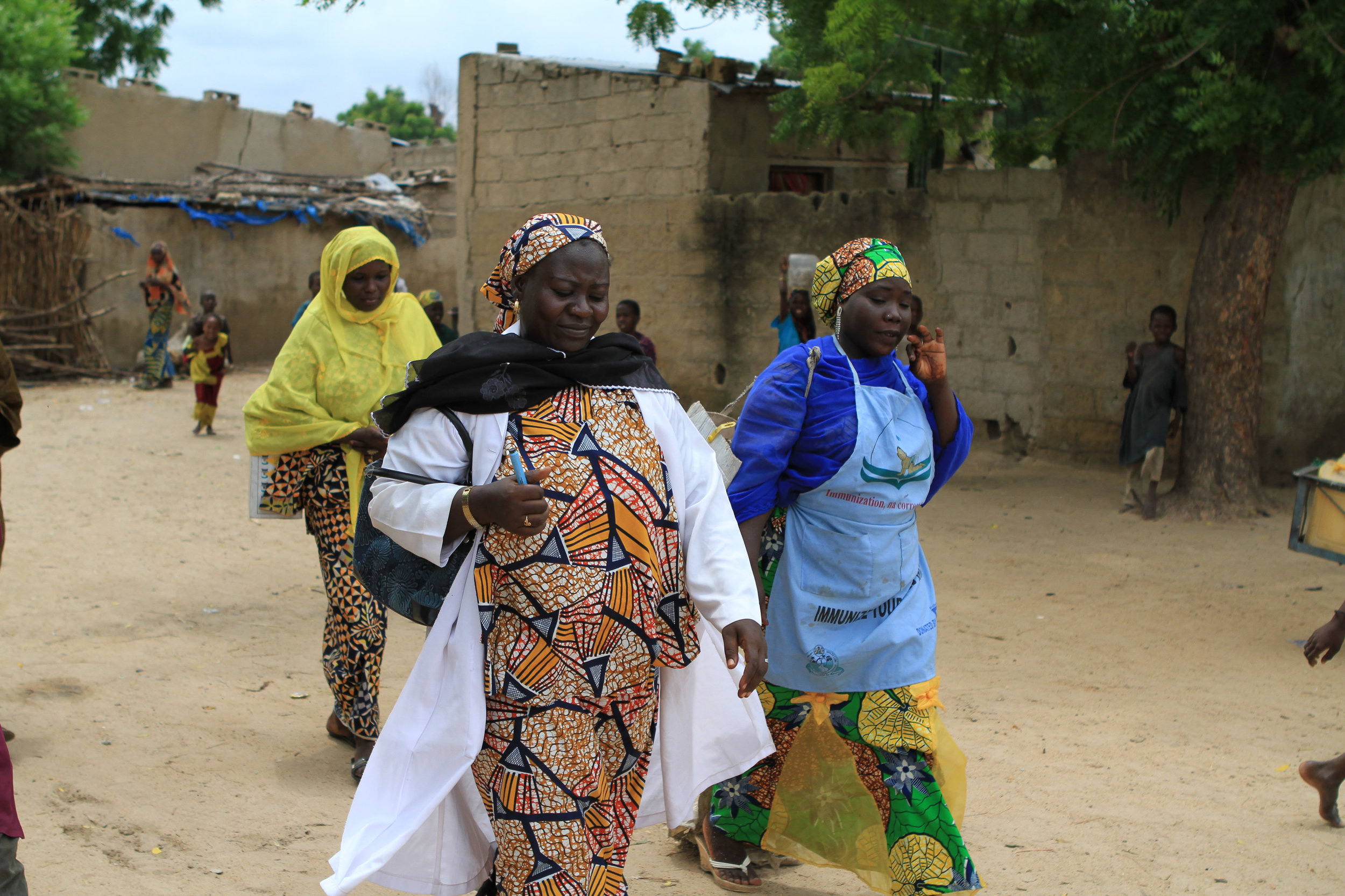 The health workers in a typical Borno town. Tidy, treed streets.
