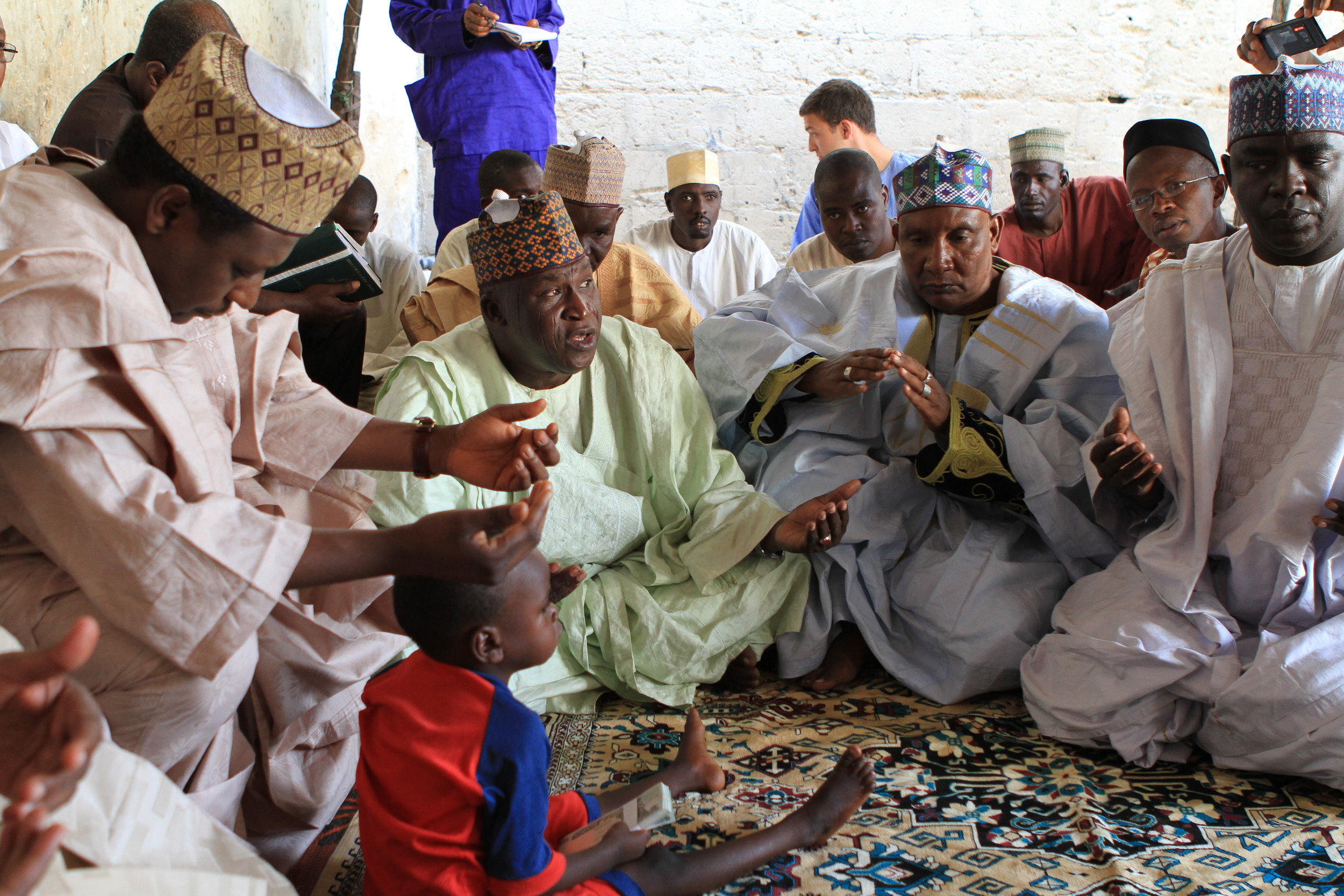 Here, we visit a family whose son was paralysed by polio. The men discuss the situation, and pray over the child.