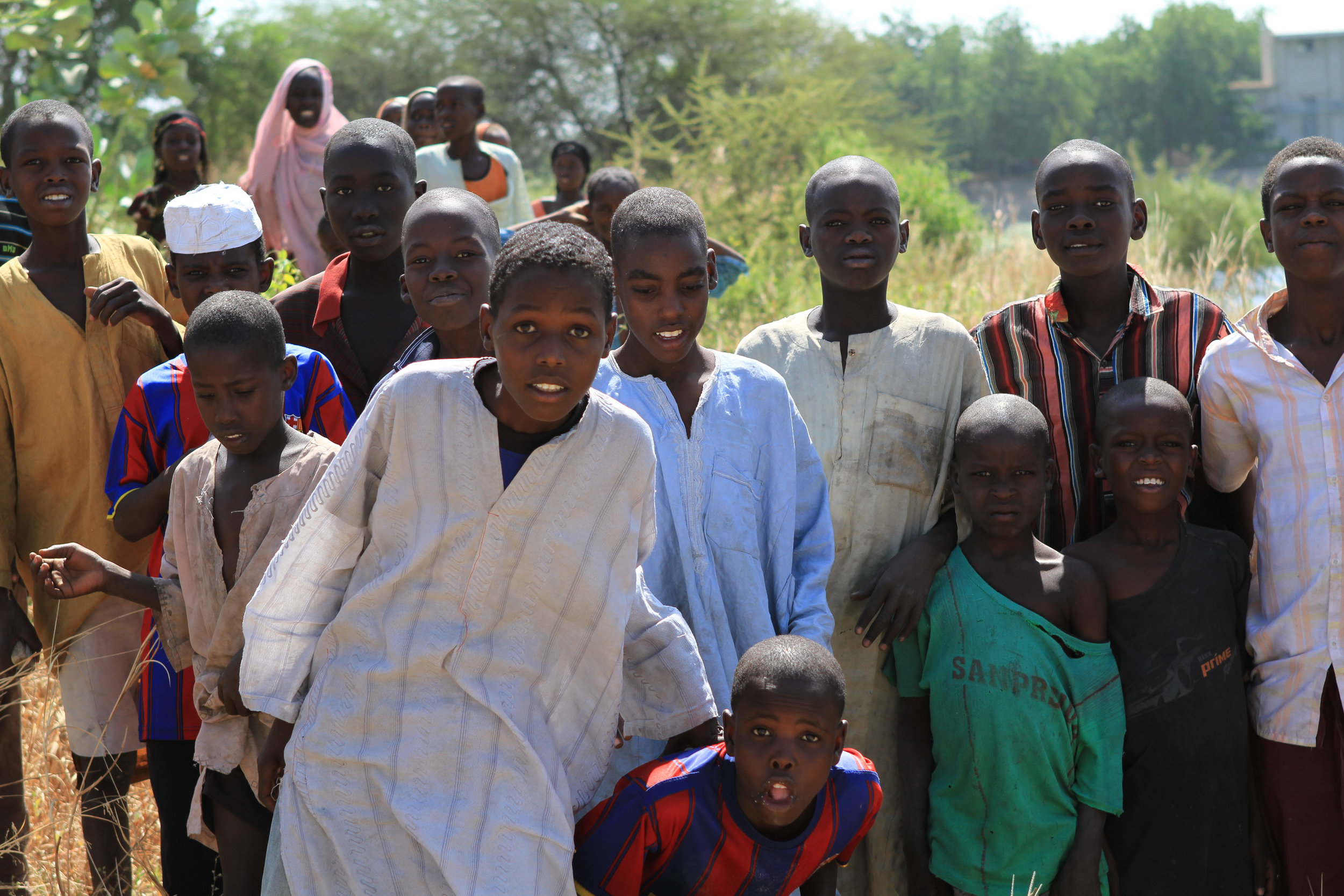 We take a boat up a canal towards Lake Chad. These boys were gathered on the shore to say hello. I'm certain this area has been badly hit by Boko Haram.