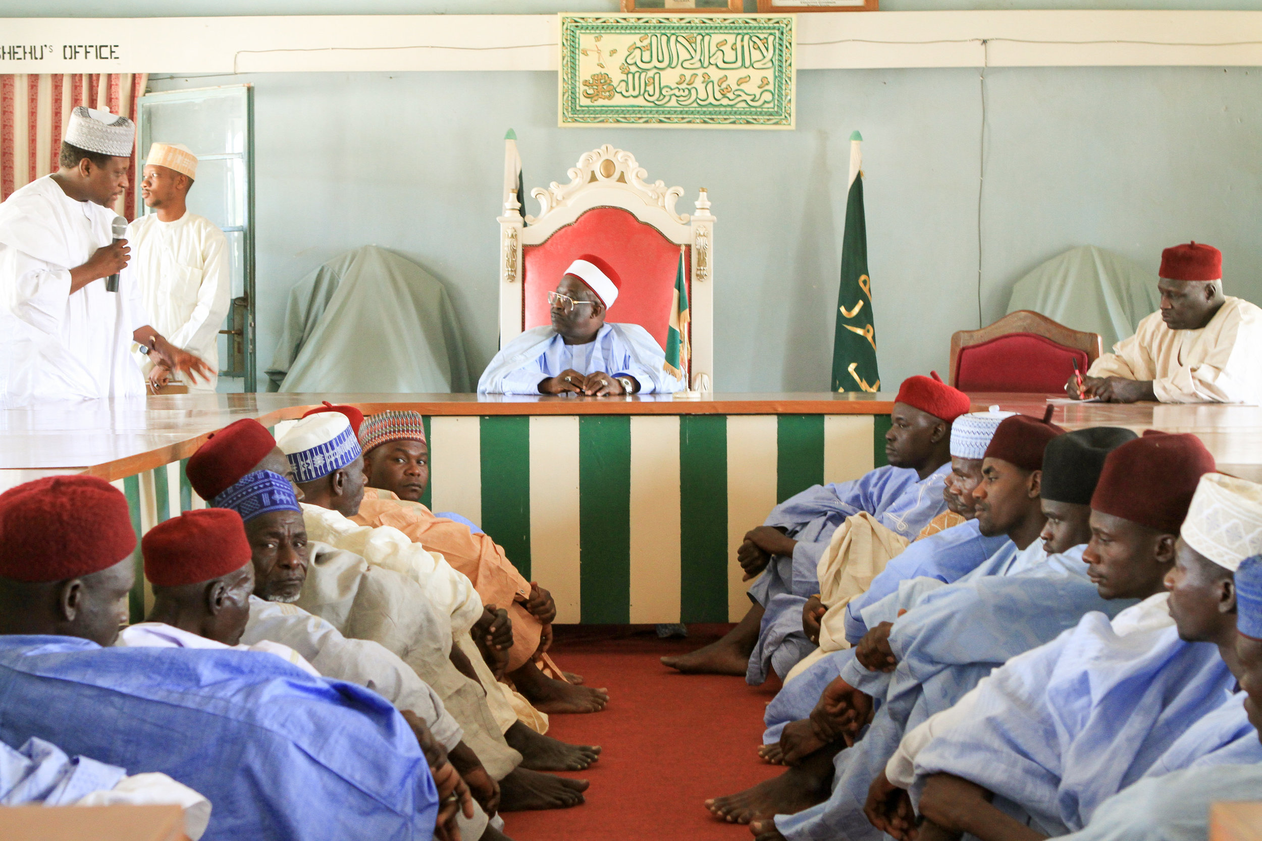"""The next day we travelled to Bama. This is the traditional leader of Bama in his """"palace."""" He greeted us warmly and promised to do more to fight polio."""