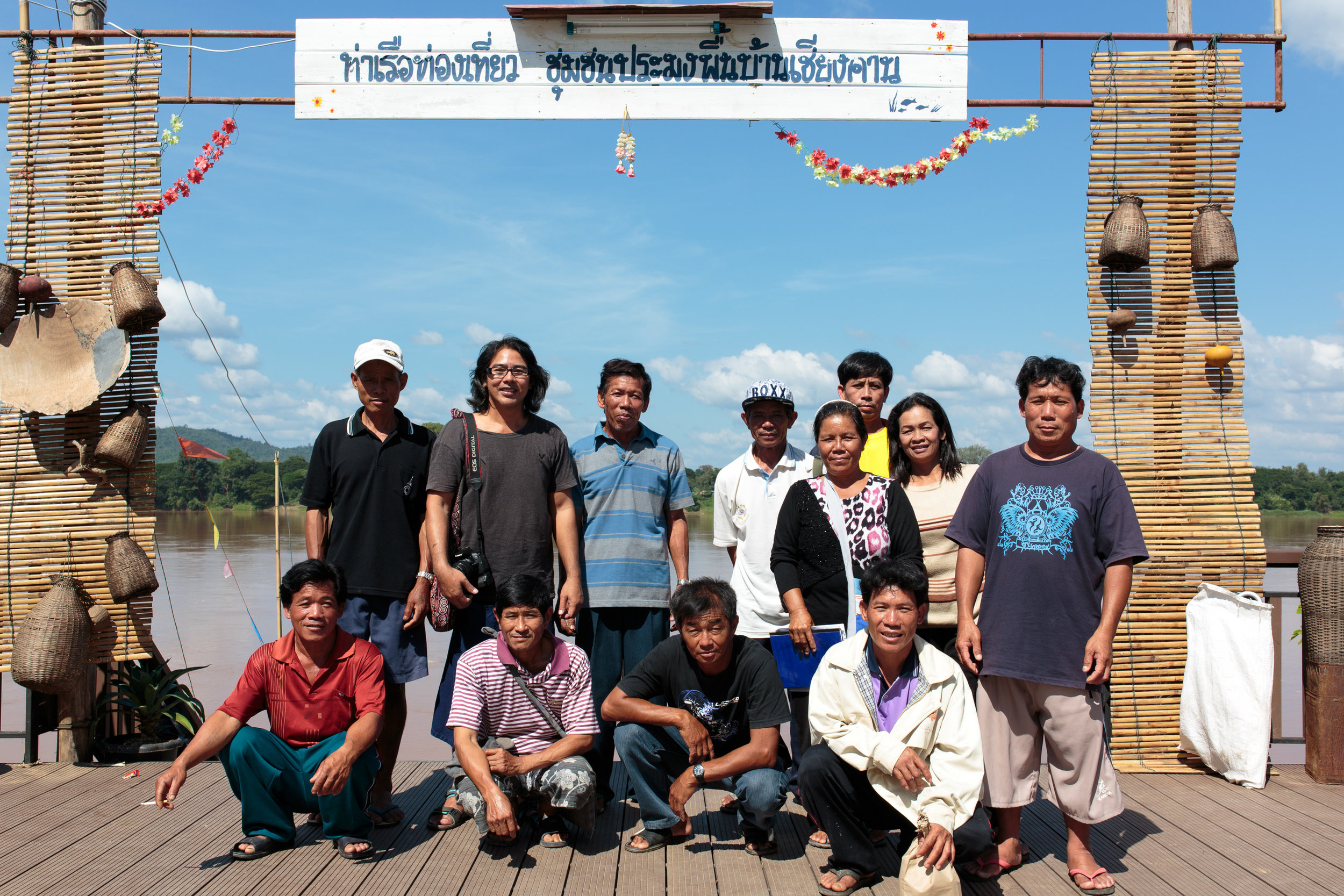Saman in the black, white and pink shirt, with the fishing association of Chiang Khan.