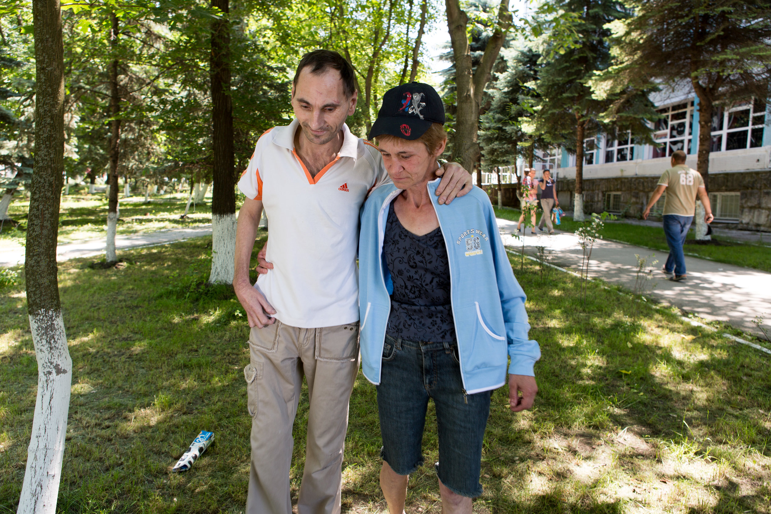 """Ludmilla helps her friend Sergei to walk. They both had TB, and stood by one another as they finished their treatment. """"When you're sick and alone, the support is so important."""""""