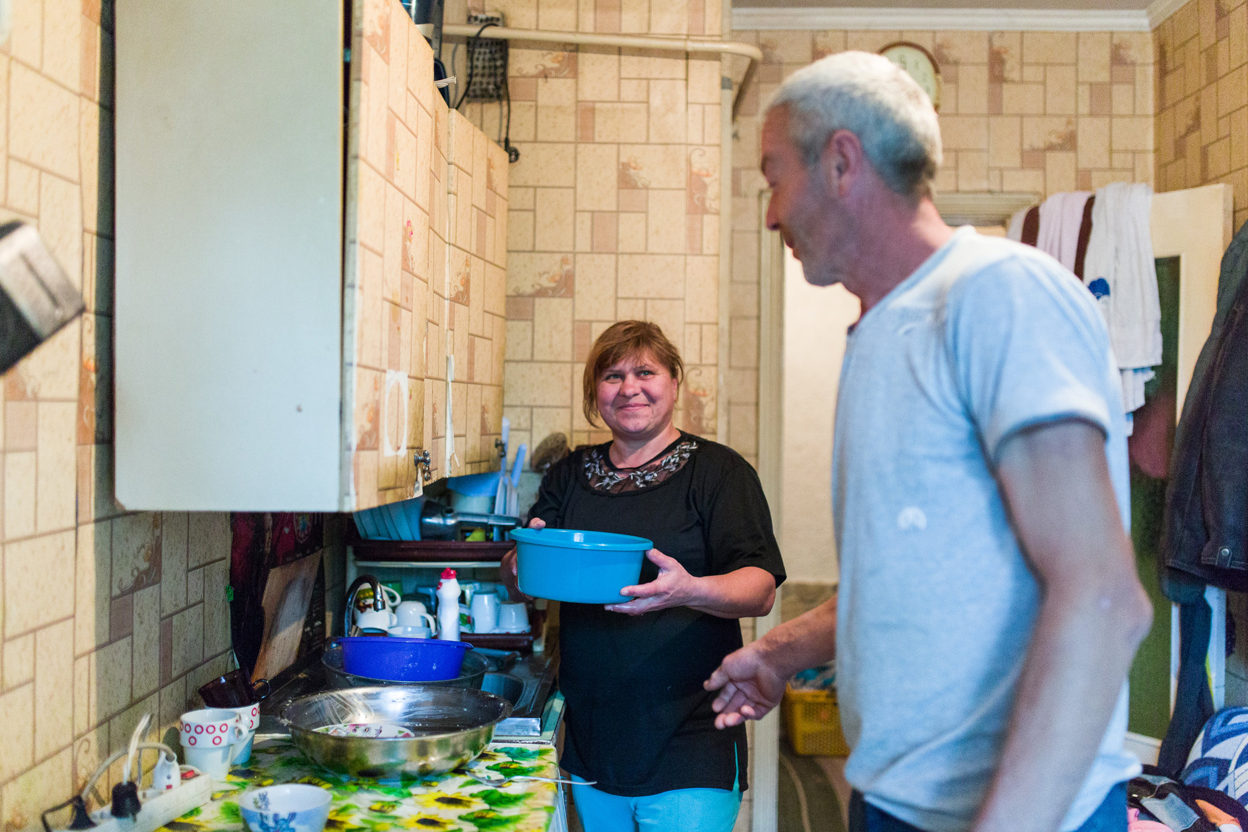 """Vera, 45, and Nicola, 44, live in Roscani vilage, about 40 minutes from Moldova's capital, Chisinau. Like many Moldovans, Nicola went abroad to Russia to work. While in St. Petersburg he lived in cramped quarters with his workmates, all working in construction.  When he returned home in 2015, Nicola had a severe cough, and Vera suggested he see the doctor. A check-up found TB. Nicola started treatment right away, and adhered to an 8-month course of daily tablets. Vera supported him to continue treatment - and she and their six children remained healthy. Now, Nicola has a clean bill of health. """"Ending TB means I don't infect other people,"""" says Nicola. """"It's normal that I supportedg him to get well,"""" says Vera. """"We should stop TB."""""""