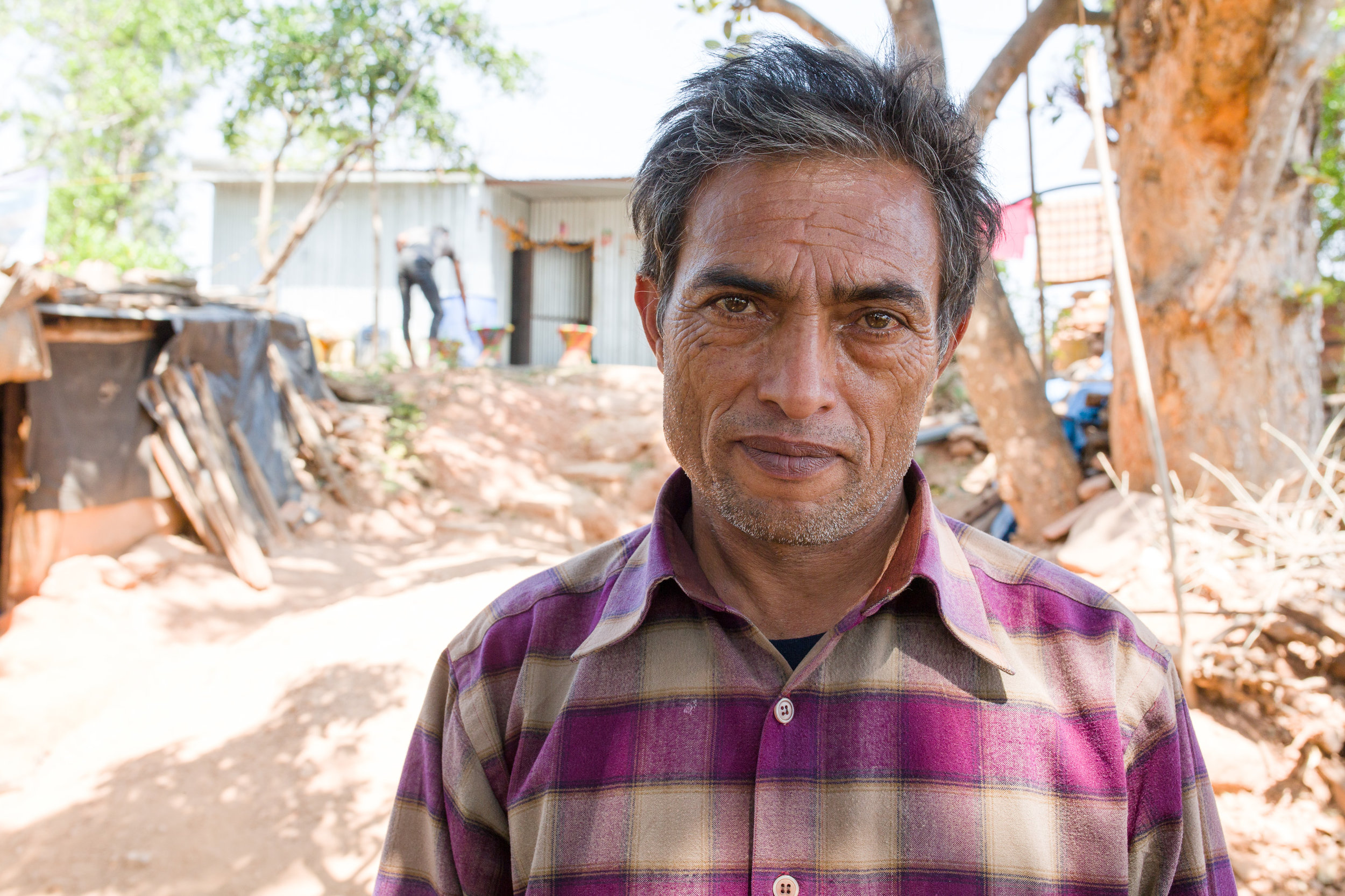 Narayan Giri's mother died from injuries she sustained in the earthquake. Here Narayan stands in front of his new temporary home.