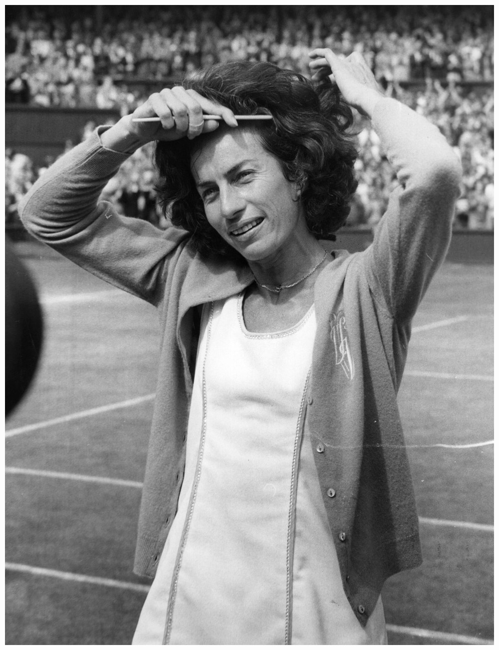British tennis player Virginia Wade combing her hair as she prepares to meet the Queen after her victory in the Women's Singles Final at Wimbledon. She beat the Dutch player, Betty Stove.