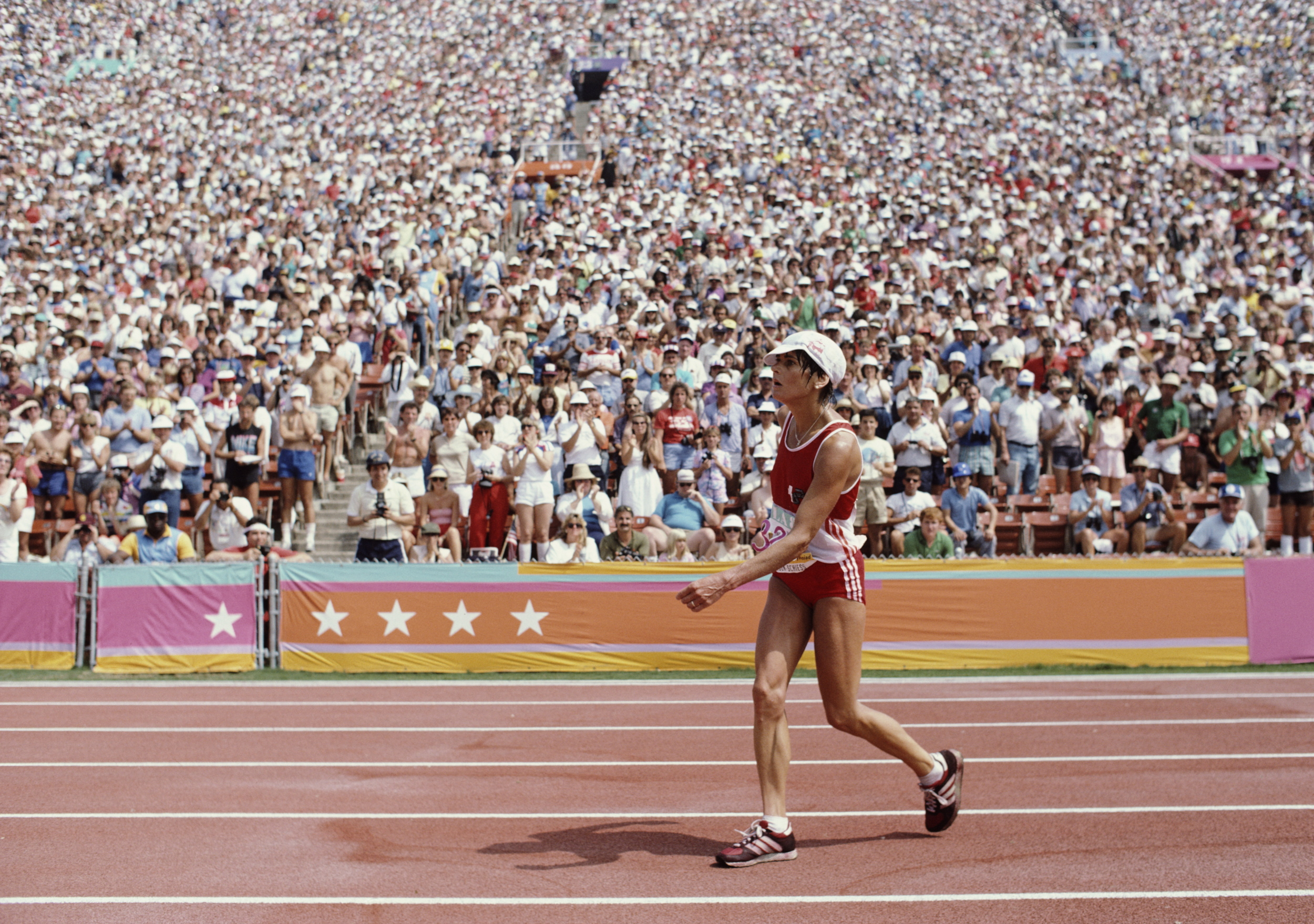 The crowd gasped in horror as she staggered onto the track, her torso twisted, her left arm limp, her right leg mostly seized. She waved away medical personnel who rushed to help her, knowing that, if they touched her, she would be disqualified. The L.A. Coliseum crowd applauded and cheered as she limped around the track in the race's final 400 meters, occasionally stopping and holding her head. While the effects of her heat exhaustion were plainly evident, trackside medics saw that she was perspiring, which meant that her body still had some disposable fluids, and let her continue her march to the finish line. At the completion of this final lap—which took Andersen-Schiess five minutes and 44 seconds—she fell across the finish line.