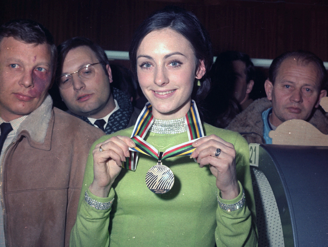 Peggy Fleming, U.S. figure skater shows off the medal she won in the Winter Olympics held in Grenoble, France, on February 1968.