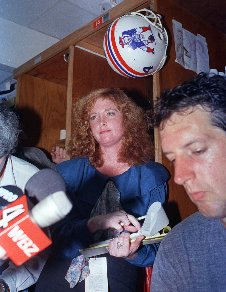 """Lisa Olson was a sports reporter for the The Boston Herald, and was one of the first women to bridge the gender divide of sports reporting since her start in the 70's.  Olson was sexually harassed in 1990, by New England Patriot players Zeke Mowatt, Robert Perryman and Michael Timpson. Mowatt walked up to her while he was nude and fondled his genitals as she was interviewing his teammate. Mowatt told her, """"Is this what you want? Do you want to take a bite out of this?"""" Then-team owner Victor Kiam II called her a """"classic bitch"""" Olson settled a lawsuit against the team, and after receiving hate mail, death threats and having her home burglarized, she moved to Australia to work for one of her employer's other newspapers."""