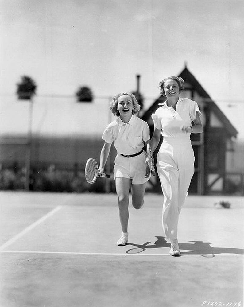 """Alice Marble (right) was the darling of international tennis and social circles in the 1930s. She was the top-ranked female tennis player in America from 1936-1940, winning five Wimbledon and 12 U.S. Open titles in singles, doubles, and mixed doubles. The first lady to serve and volley, and noted for aggressive play called the """"killer instinct"""" approach.s  Her public life was filled with success, but her private life was a different story. Marble was fatherless at six, raped at 15, and diagnosed with tuberculosis at 19, just as her tennis career was taking off. A genuine """"comeback kid,"""" she overcame obstacles that would have defeated a lesser person. After the biggest personal trauma of her life, she consented to undertake a spy mission for the U.S. Army during WWII."""