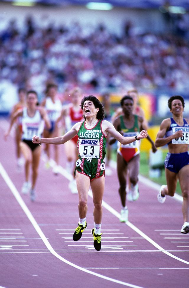 """Under intense pressure and facing death threats from Islamist radicals, Boulmerka became the first Algerian woman to win an Olympic title at the 1992 Olympics in Barcelona. In the lead up to the Olympics, Boulmerka was forced to train in Berlin due to the militant uprising in Algeria: """"It was too risky. I could have been killed at any moment"""". Boulmerka later served on the Athlete's Commission of the International Olympic Committee (IOC)."""