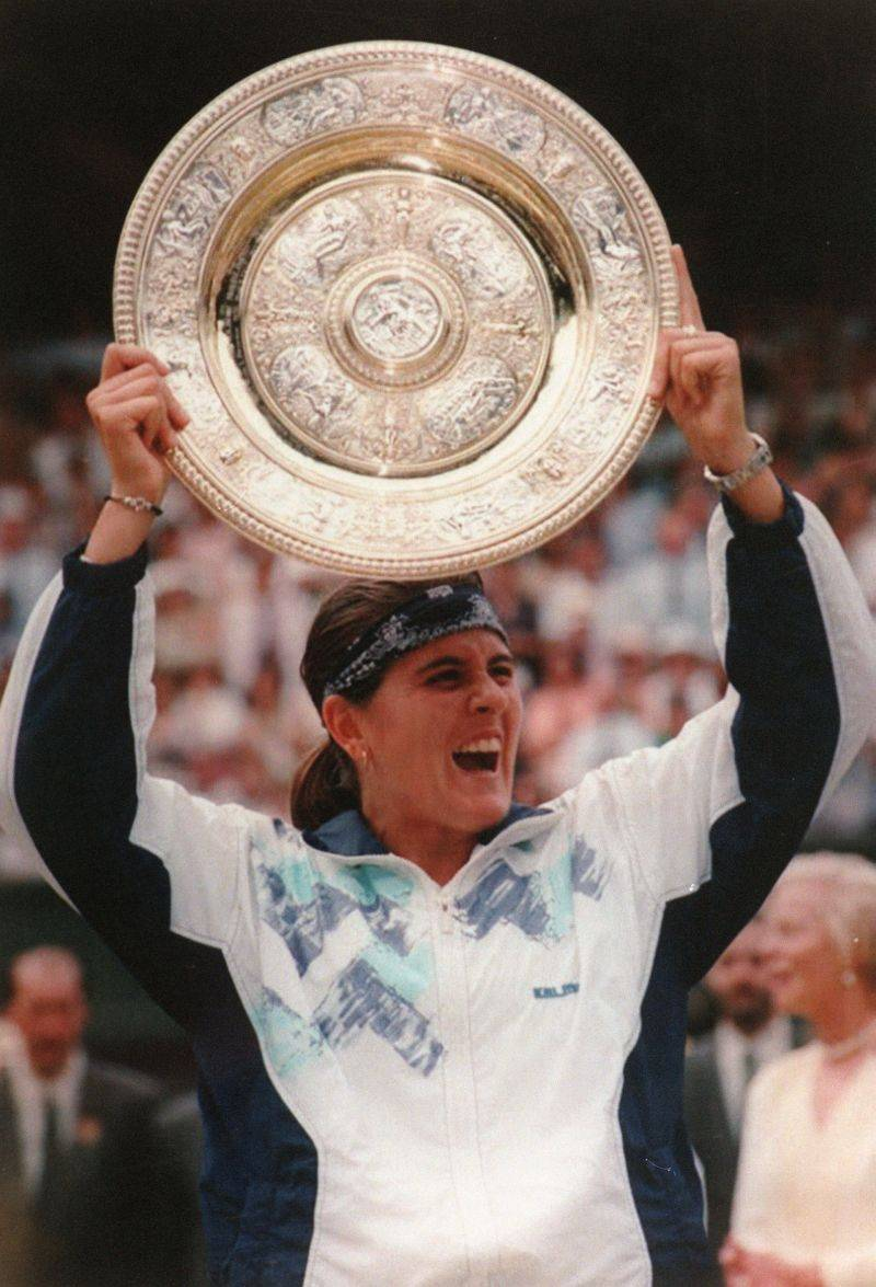 The only Spanish woman to win the women's singles title at Wimbledon, Martinez defeated Martina Navritalova to take the crown in 1994.  Martinez has won three Olympic medals in doubles competition and holds the record for most professional tournament wins by a Spanish female tennis player.  Although she never formally came out, Martinez's relationship with fellow tennis players Gigi Fernandez and Patricia Tarabini were widely known. Martinez is currently the captain of the Spain Fed Cup team.