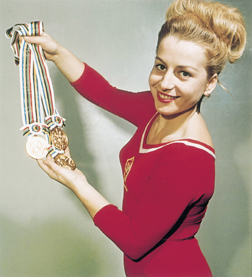 Czech gymnast Vera  C áslavská dominated the sport during the 1960s, winning seven Olympic gold medals in individual events. She is the only gymnast, male or female, to have won gold in each discipline.  A vocal supporter of the Czech democratic movement,  C áslavská opposed the Soviet influence on her home country, often looking away when the national anthem was played at events.  As a result of her outspoken stance, the new Soviet regime barred her from travelling or attending sporting events, effectively forcing her into retirement.  The ban was later lifted with the help of the IOC and  C áslavská went on to hold several distinguished positions, including President of the Czech Olympic Committee.