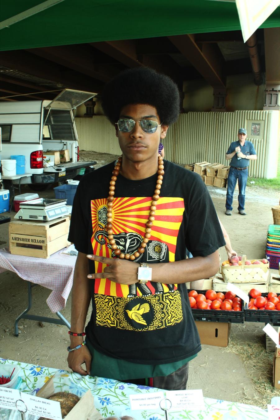 Ayinde at the Brookland farmer's market. Copyright Will Allen-DuPraw 2014