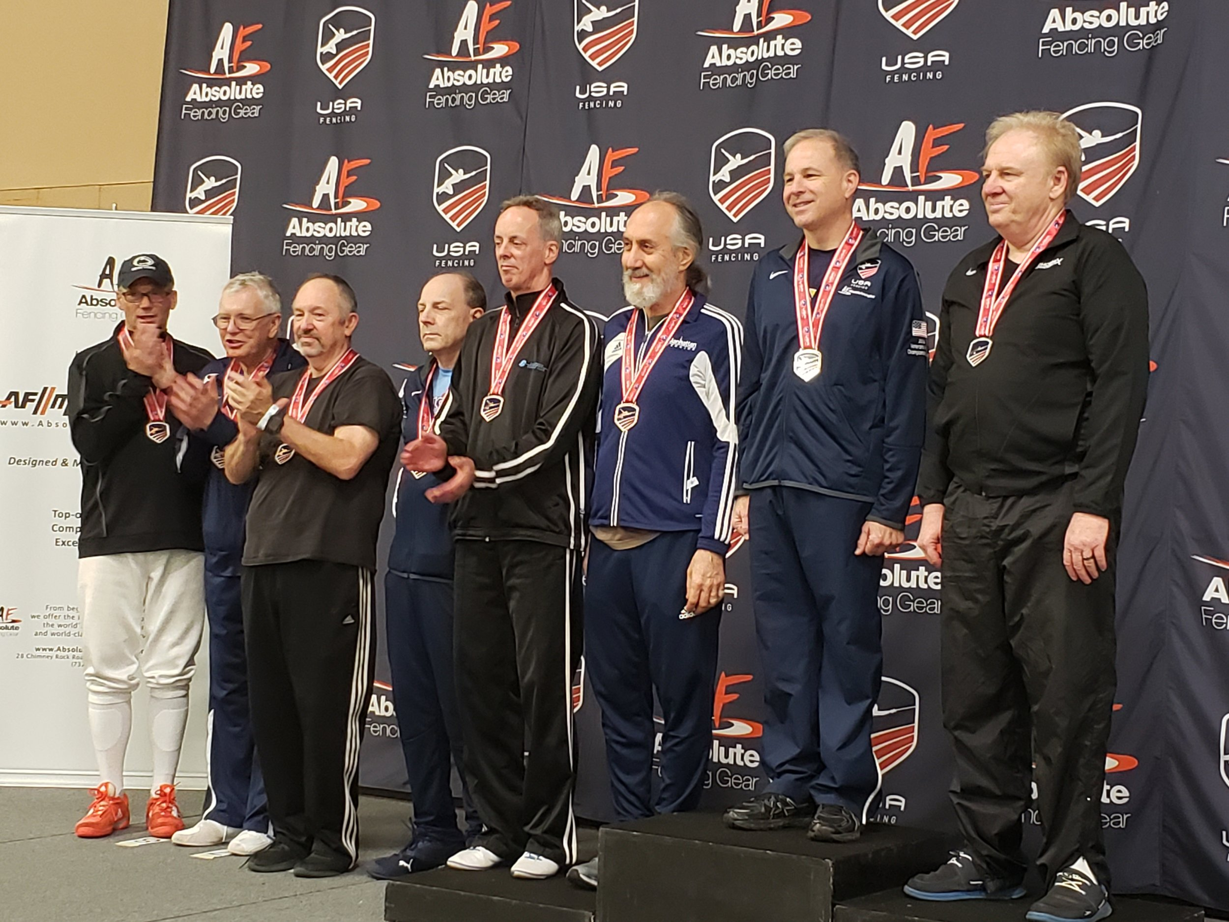 Jeff (3rd from left) accepting his medal for 6th place in Veterans 60-69 Men's Saber.