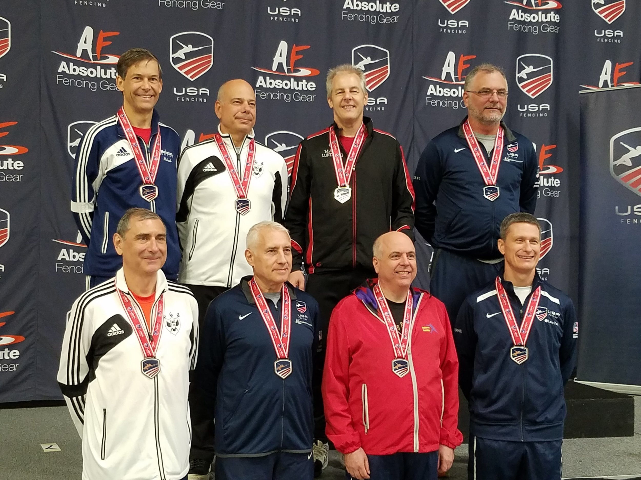Mark (top row, second from right) receiving his GOLD medal for Veteran 50-59 Men's Saber.
